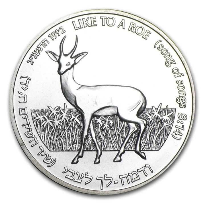 上图:1992年的以色列1舍客勒硬币,上面的图案是西方狍(Roe Deer)和百合花,写着「如一只小鹿」(歌8:14)。